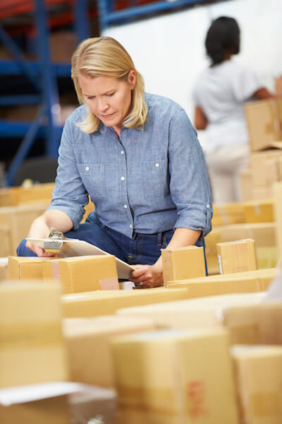 woman-in-warehouse-preparing-goods-for-dispatch
